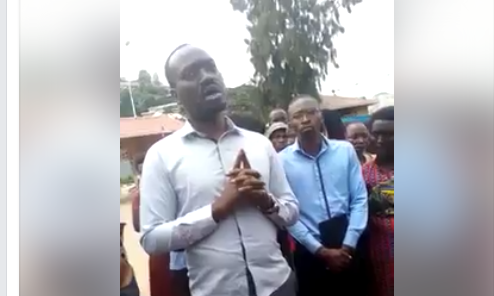 On this clip, a family is being briefed by Kagame's Directorate of Military Intelligence (DMI) to not take pictures during the burial of their relative(s)